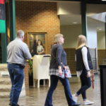 A student shows her parents around the Student Center.